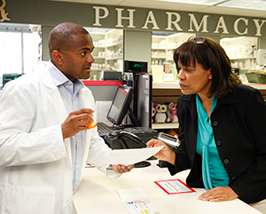 Woman talking to pharmacist.