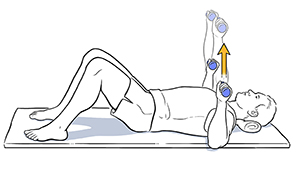 Man lying on back doing chest press exercise with hand weights.
